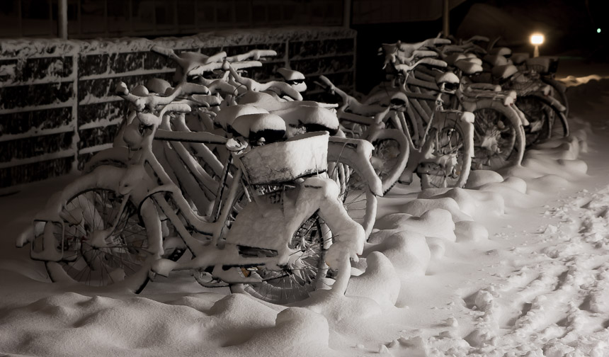 bicycles covered with snow | photo by Filip Pobocik